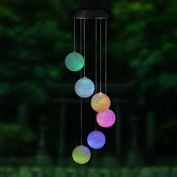 Solar Lighted Wind Chime features 6 color changing lights that turn on when the Sun goes down.